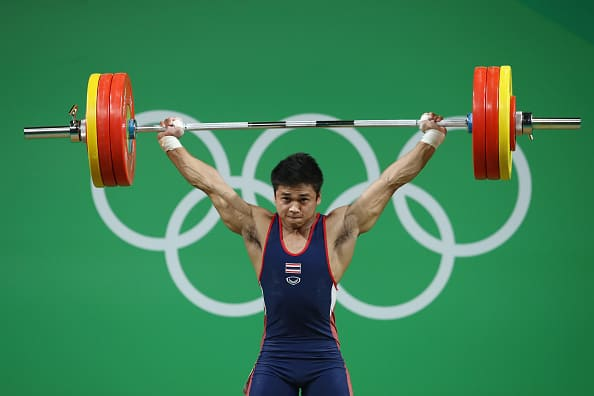 RIO DE JANEIRO, BRAZIL - AUGUST 10:  Chatuphum Chinnawong of Thailand lifts during the Men's 77kg Group A weightlifting contest on Day 5 of the Rio 2016 Olympic Games at Riocentro - Pavilion 2 on August 10, 2016 in Rio de Janeiro, Brazil.  (Photo by Julian Finney/Getty Images)