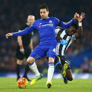 LONDON, ENGLAND - FEBRUARY 13: Cesc Fabregas of Chelsea is tacked by Cheik Ismael Tiote of Newcastle United during the Barclays Premier League match between Chelsea and Newcastle United at Stamford Bridge on February 13, 2016 in London, England. (Photo by Clive Mason/Getty Images)