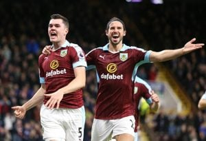 BURNLEY, ENGLAND - SEPTEMBER 26: Burnley's Michael Keane, left, celebrates scoring his sides second goal with team-mate Burnley's George Boydge during the Premier League match between Burnley and Watford at Turf Moor on September 26, 2016 in Burnley, England. (Photo by Alex Dodd/CameraSport via Getty Images)