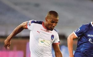 (FILES) This file photo taken on October 8, 2015, shows Delhi Dynamos FC midfielder Florent Malouda as he dribbles the ball during the Indian Super League (ISL) football match between Delhi Dynamos F.C and Chennaiyin F.C. at The Jawarharlal Nehru Stadium in New Delhi. Former Lyon and Chelsea star Florent Malouda has returned for the third edition of the Indian Super League (ISL) as the marquee player for Delhi Dynamos. The French international, who won four consecutive Ligue 1 titles with Lyon and the 2012 UEFA Champions League crown with Chelsea, was one of the high-profile signings for Delhi in ISL-2. / AFP PHOTO / ROBERTO SCHMIDT